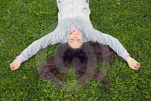 Pretty Girl Lying On The Grass Royalty Free Stock Photography - Image: 14040587