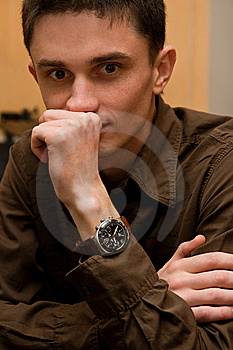 Young man sitting at the table Free Stock Photos