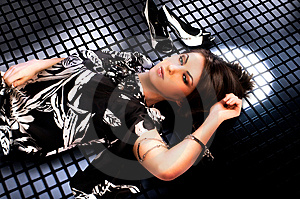 Woman Lays On Grating Royalty Free Stock Images - Image: 14051799