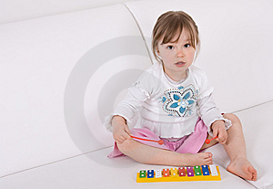 Little Girl With Instrument Royalty Free Stock Image - Image: 14054526