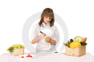 Cook Girl Makes Carving A Mango Royalty Free Stock Photography - Image: 14055657