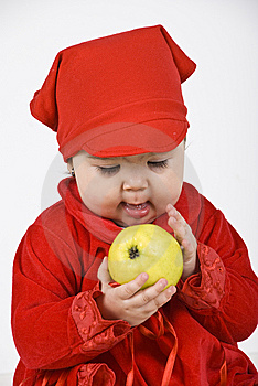 Baby Girl Holding And Caress An Apple Royalty Free Stock Photography - Image: 14064427