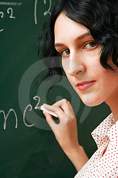 Student Writing On The Blackboard Royalty Free Stock Photo - Image: 14070985