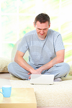 Man Relaxing With Laptop Stock Photo - Image: 14073690