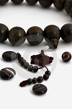 A String Of Wooden Beads And Agates Ball Royalty Free Stock Photos - Image: 14076418