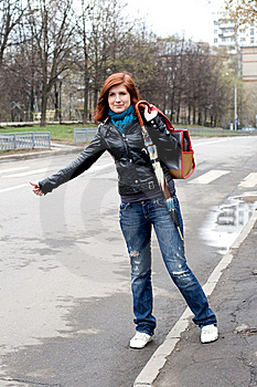 Girl Stopping A Car Stock Images - Image: 14080604