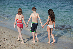 Teenagers Walking Along Beach Shoreline Royalty Free Stock Photo - Image: 14084605
