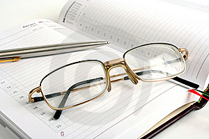 Notebook, Pen And Eyeglasses Royalty Free Stock Image - Image: 14085106