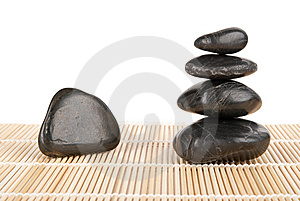 Some Stones Lie Pyramid On Mat Stock Photography - Image: 14089352