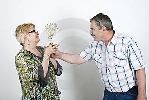 Middle Aged Man Giving Flowers To His Wife Stock Photo - Image: 14090250