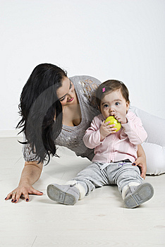 Toddler  Bite A Green Apple Stock Image - Image: 14090291