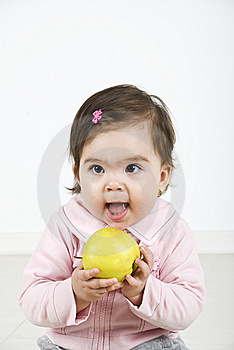 Cheerful Baby Ready To Bite An Apple Royalty Free Stock Images - Image: 14090299