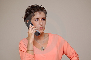 Young Woman Talking On Cell Phone Stock Photography - Image: 14094932