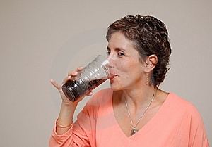 Young Woman Drinking Soda Stock Photo - Image: 14094940