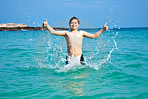 Smiling Boy Enjoys Swimming  In The Sea Royalty Free Stock Image - Image: 14096946