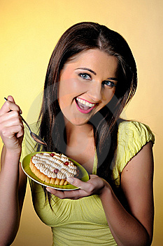 Young Beautiful Girl Eating Small Sweet Cake Stock Photo - Image: 14098510