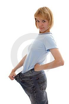 Slim Girl In Big Size Jeans Free Stock Photo