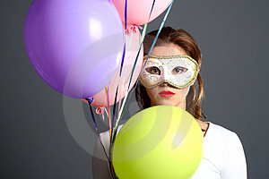 Brunette With Mask And Balloons Royalty Free Stock Photography - Image: 1418527