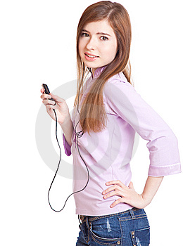 Young Girl Listening To Music Om Mp3 Player Stock Photos - Image: 14105693