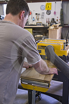Man Planing Board With Machine Planer Royalty Free Stock Images - Image: 14122069