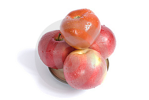Apples And Tomato On A Plate Royalty Free Stock Photography - Image: 14122617