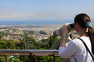 Woman Looking Through A Coin Operated Binoculars Royalty Free Stock Photography - Image: 14136357