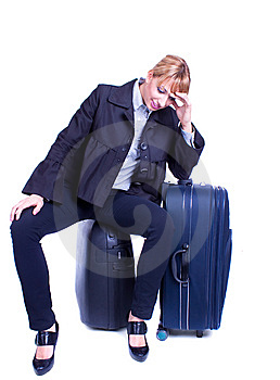 Businesswoman Sits On Black Suitcase And Waiting Stock Photos - Image: 14138063