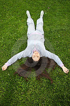Girl Lying Upside Down On Fresh Grass Royalty Free Stock Images - Image: 14140389