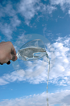 Glass Of Water Against A Cloudy Sky Stock Photos - Image: 14144303