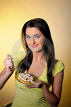 Young Beautiful Girl Eating Small Sweet Cake Stock Images - Image: 14151174