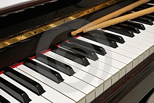Diagonal Shot Of Drum Sticks On Piano Keyboard Royalty Free Stock Photos - Image: 14167068