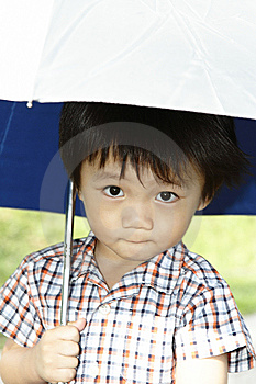 Cute Asian Boy With Umbrella Stock Images - Image: 14172734