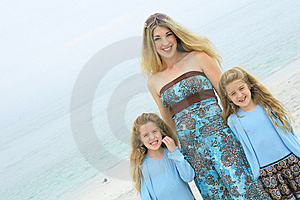Mother And Twin Daughters At The Beach Stock Photography - Image: 14173172