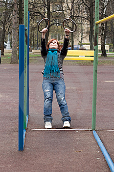 Sportive Girl Hanging On The Rings Stock Image - Image: 14174041