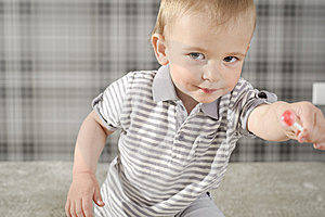 Boy With Lollipop Stock Photos - Image: 14174403