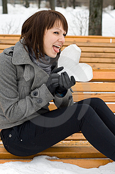 Girl Holding An Ice Heart Royalty Free Stock Photo - Image: 14187305