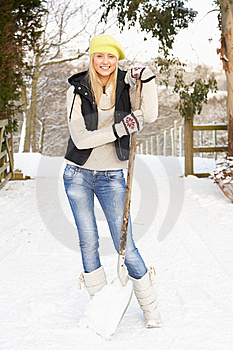 Teenage Girl Clearing Snow From Drive Stock Image - Image: 14188891