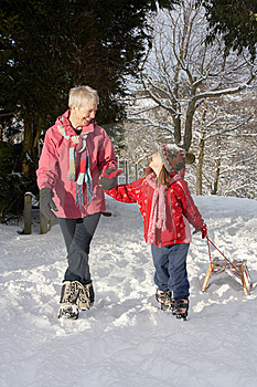 Young Girl With Grandmother Pulling Sledge Royalty Free Stock Photos - Image: 14189028