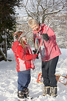 Young Girl Showing Grandmother Icicle In Snowy Lan Stock Photography - Image: 14189032