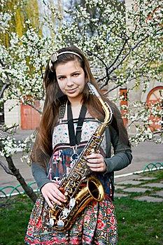 Beautiful Girl With Saxophone Royalty Free Stock Photo - Image: 14192715