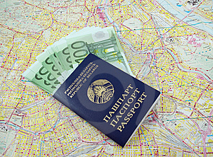 Passport With Money Over Map Stock Photo - Image: 14192780