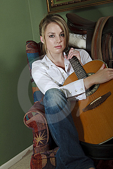 Beautiful Female With Guitar Royalty Free Stock Photo - Image: 14192885
