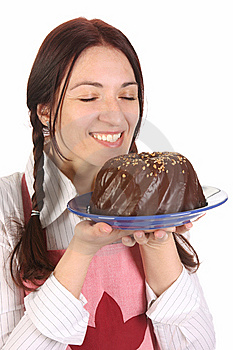 Housewife  With Bundt Cake Royalty Free Stock Image - Image: 14192896