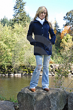 Woman Standing On A Rock Royalty Free Stock Photos - Image: 14203918