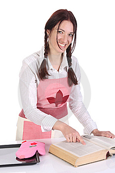 Housewife Preparing And Reading With A Book Recipe Royalty Free Stock Photography - Image: 14208077