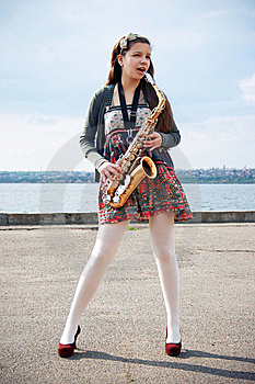 Beautiful Girl With Saxophone Stock Image - Image: 14208141