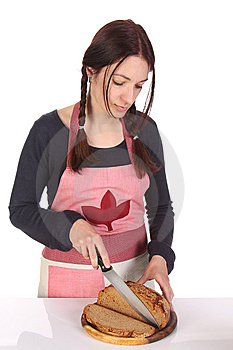 Beautiful Housewife Cutting Bread With Knife Royalty Free Stock Images - Image: 14208969