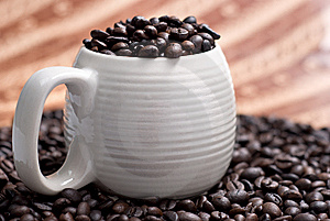 Coffee Beans In A Cup With Ethnic Mood Royalty Free Stock Photos - Image: 14211958