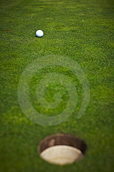 Single Golf Ball Beside The Hole Stock Image - Image: 14225911
