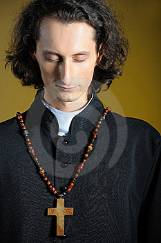 Praying Priest With Wooden Cross Stock Images - Image: 14226754